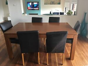 Extension teak dining table with 6 leather chairs Grays Point Sutherland Area Preview