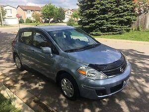 2012 Nissan Versa Hatchback 1.8SL still under warranty $7500