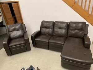 Leather chaise sofa with rocker recliner in dark brown leather