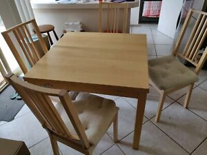 Extendible dining table set (includes chairs)