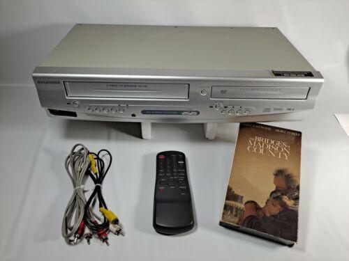 SYLVANIA VCR/DVD COMBO, MODEL DVC-840F. PLUS EXTRAS. SEE VIDEO. READ DESCRIPTION