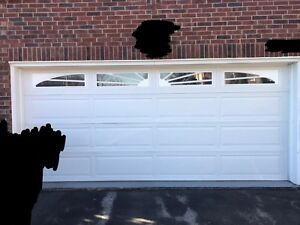 Insulated 16x7 garage door. (Already dismantled)