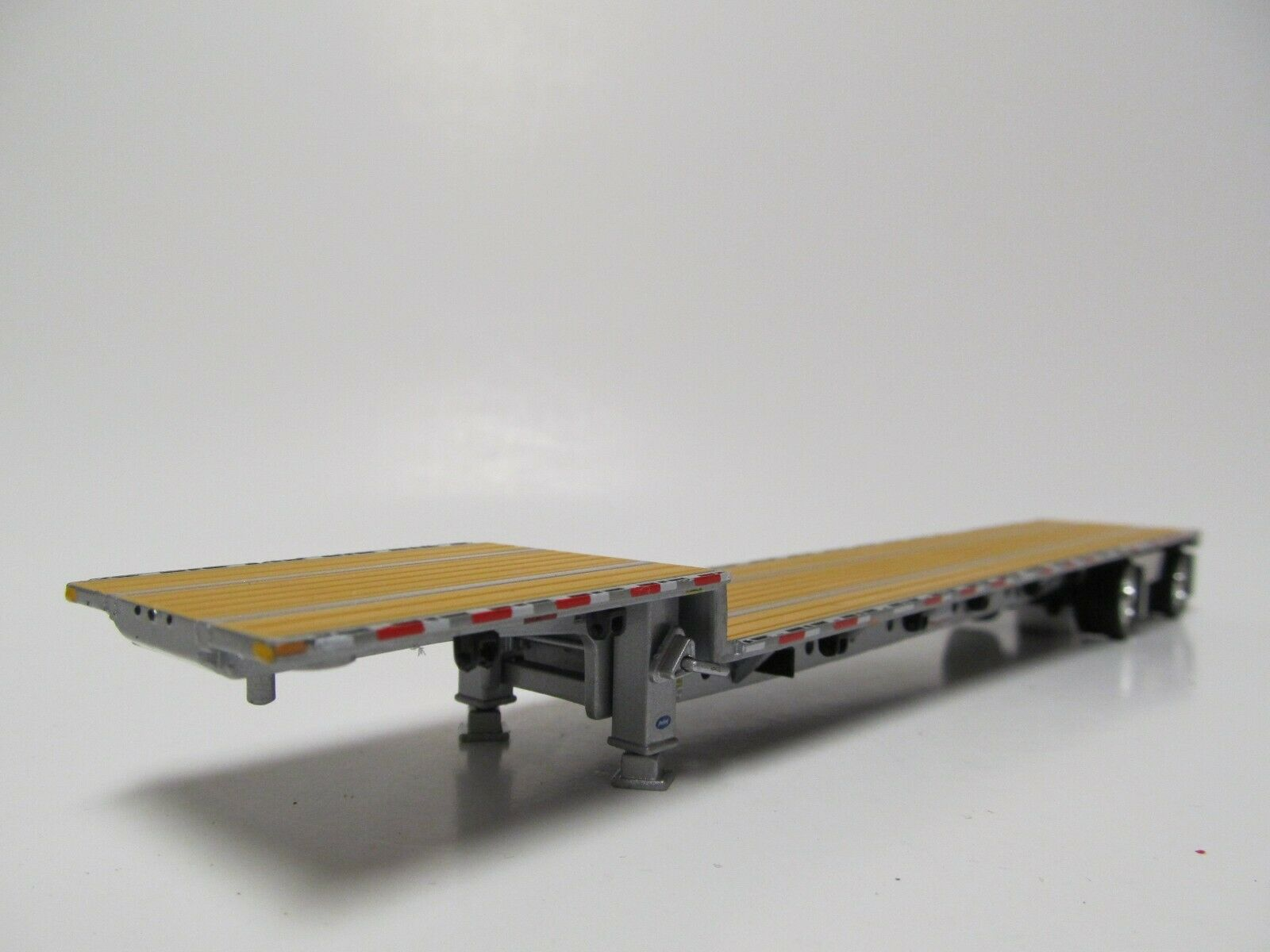 DCP 1/64 SCALE TRANSCRAFT STEP DECK TRAILER TAN / BROWN DECK WITH SILVER FRAME