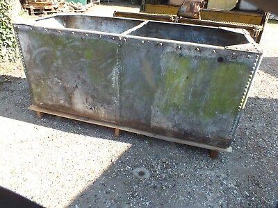 vintage riveted galvanized tank