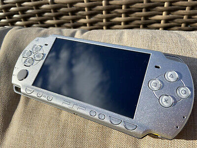 Sony PSP-3000 Portable Mystic Silver with Memory Card and Assorted Games