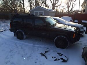 Trade 2000 Jeep Cherokee for Car/Equipment trailer
