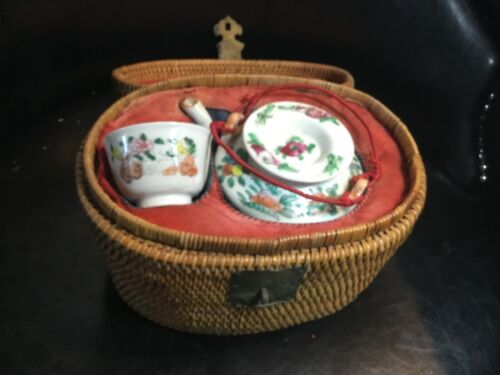 CHINESE PORCELAIN TEAPOT in basket