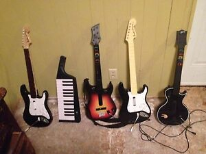 3 Rock band games, mic, 6 instruments - Xbox 360