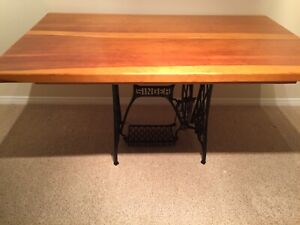 Pine table with antique sewing machine base