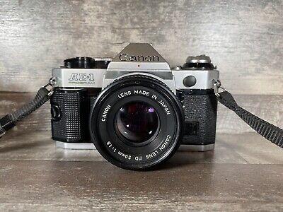 Canon AE-1 Program 35mm SLR Film Camera with 50 mm lens Kit