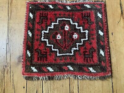 OLD HAND KNOTTED VILLAGE RUG WITH ANIMAL MOTIFS.
