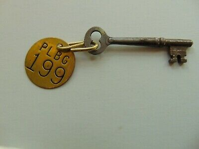 Made in the 1960s Vintage pair silver metal Dutch cabinet keys with a round eye