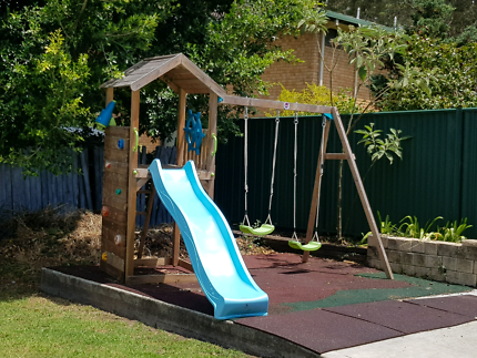 Plum swing set with climbing tower and sand pit