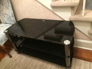 A black 3 shelves large glass TV stand