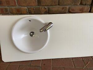Round sink and tapware