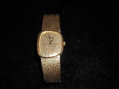 583 18k yellow gold Piaget ladies wrist watch asymmetrical  model depose 7 inch