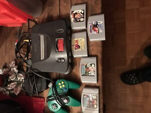 Used Nintendo N64 and Games and 1 controller