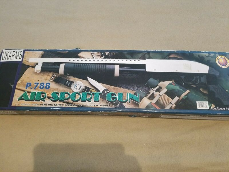 Ukarms spring powered shotgun 6mm bbs included. Item is new with opened box.