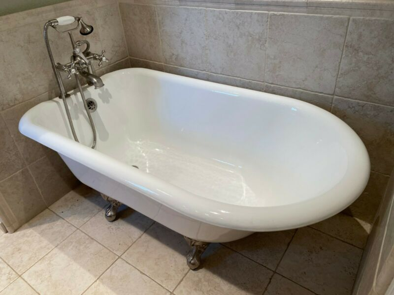 Cast Iron Clawfoot Tub by recor with British Telephone style faucet fixtures
