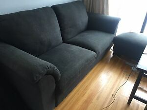 Comfy dark blue couch with stool