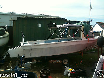 16 foot fishing boat with outboard pod and cuddy