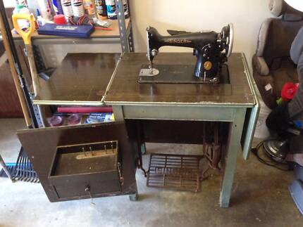 Vintage Singer single treadle sewing machine in cabinet