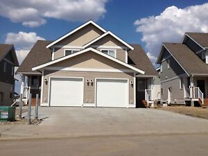 NEWER DUPLEXES IN NEW HARVEST VIEW SUBDIVISION