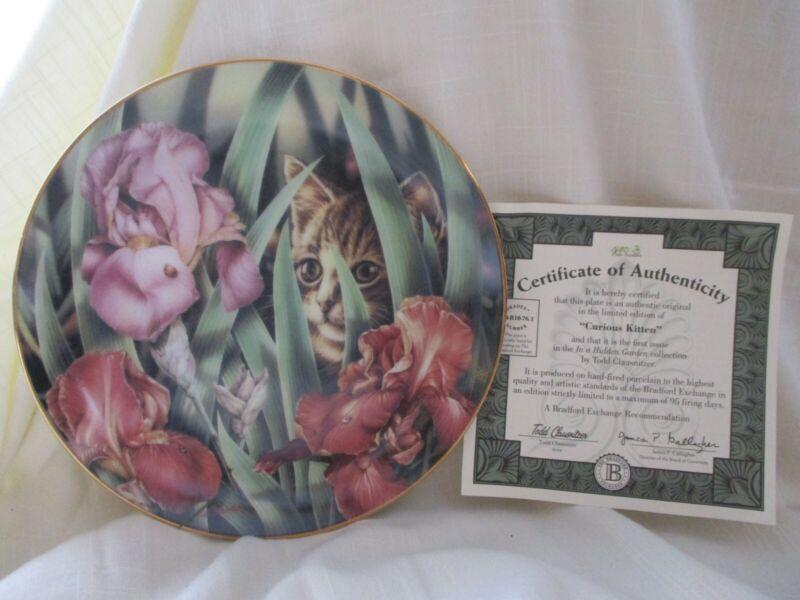 """In a Hidden Garden"" set of 4 collector cat plates by artist Todd Clausnitzer."