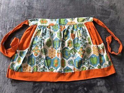 Vintage Aprons, Retro Aprons, Old Fashioned Aprons & Patterns Vintage Orange Vegetables Half Apron Reversible w/ Pockets $14.99 AT vintagedancer.com