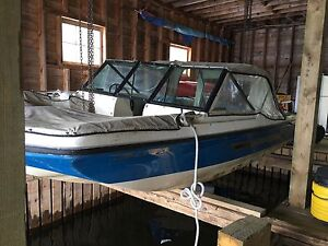 REDUCED!!!  Fiberglass boat and motor for sale