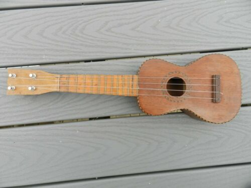 vintage  ukulele model 1920 ? plays nice good tone  4