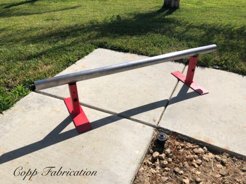 Adjustable skateboard grinding rail