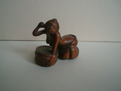Small boxwood semi nude female figure  netsuke