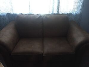 Couch. Chocolate brown loveseat
