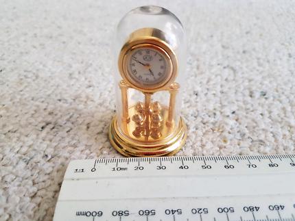 Miniature Mantle Clock under a dome