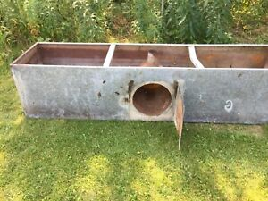 Antique water trough with stove