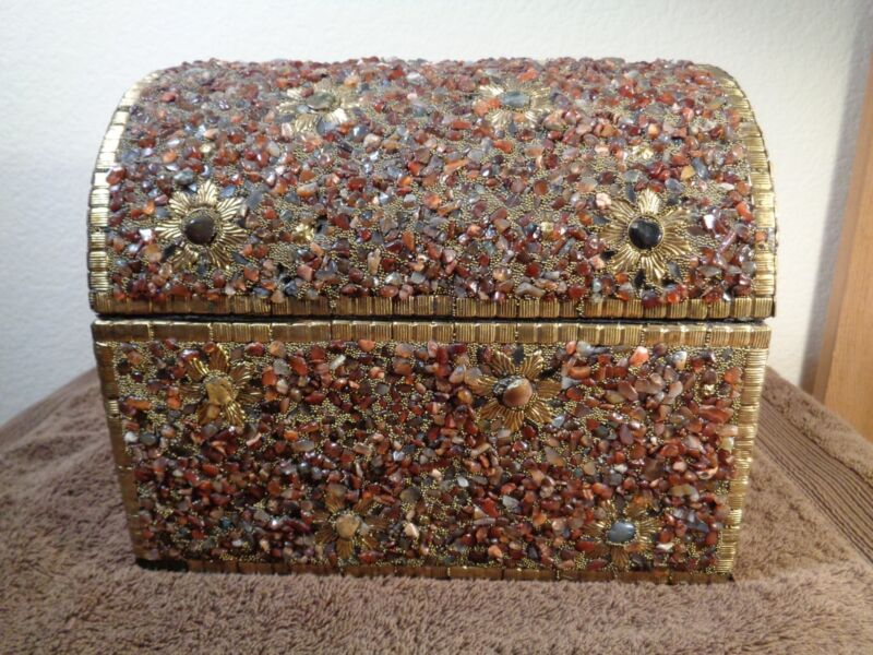 Wooden chest covered with pebbles