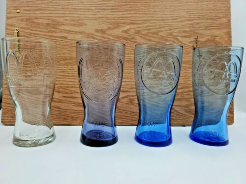 """Set Of 4 McDonalds """"Through the Years"""" Collector Drinking Glasses"""