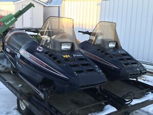Pair of Indy Cross Country sleds and trailer