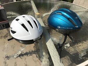 2 Louis Garneau bike helmets