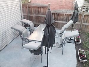 Patio set with large table and 6 chairs with cushions.