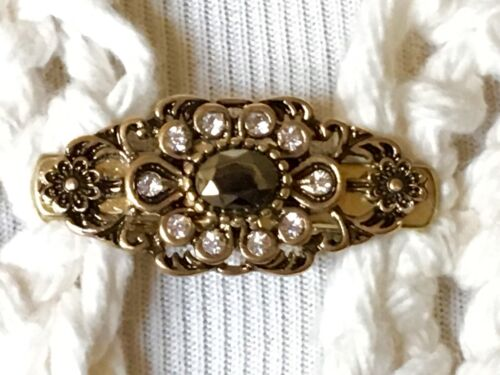 The mattie slender antiqued gold, brown stone and rhinestone flower sweater clip