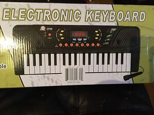 Mini Electronic Keyboard - Brand New!!