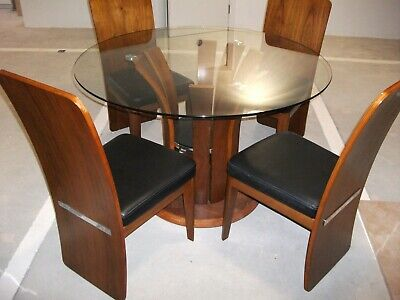second hand circular glass topped dining table with 4 chairs