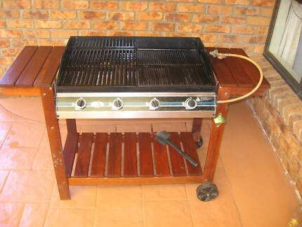 Four Burner BBQ including cover and gas bottle