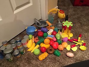 Play - kitchen and the food and cans and utensils.