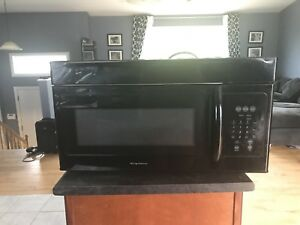 Black Frigidaire over the range Microwave