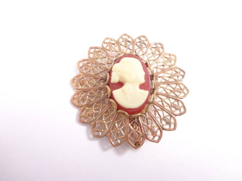 Vintage brooch lace design frame brass red cameo design in the middle