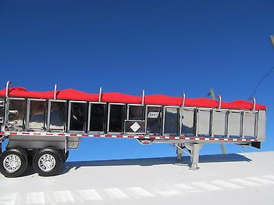 DCP 1/64 SCALE EAST END DUMP TRAILER WITH CHROME SIDES SILVER FRAME RED TARP