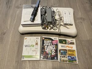 Nintendo Wii with Fit board  + games